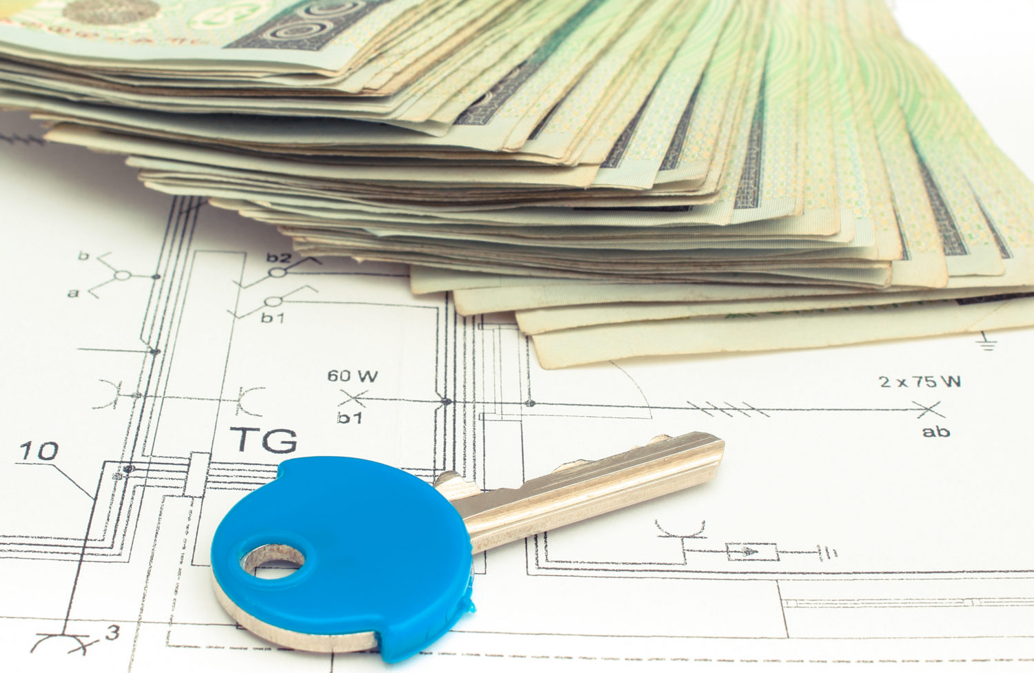 Electrical construction drawings with polish money and home key, building home cost concept